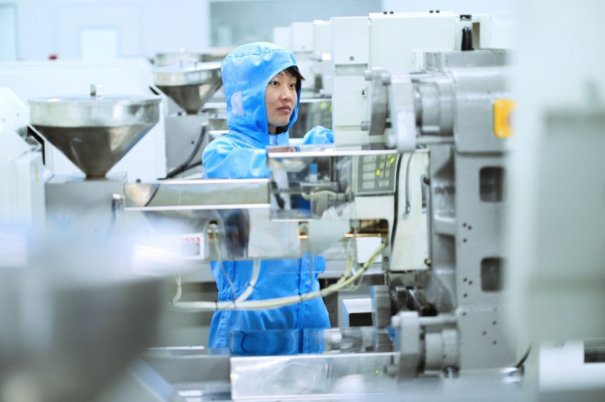 A worker on a high-tech production line