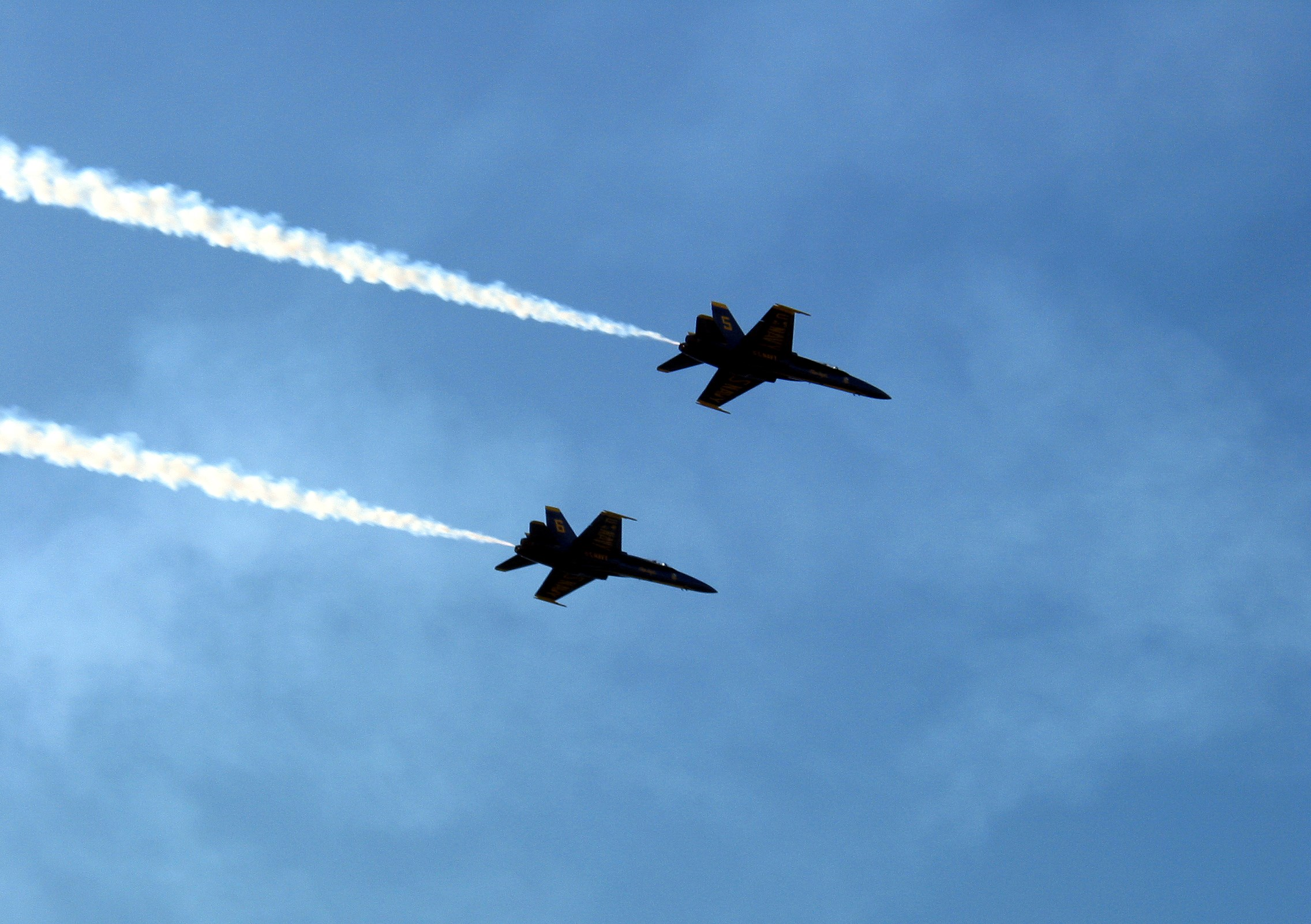 Jet fighters against a blue sky