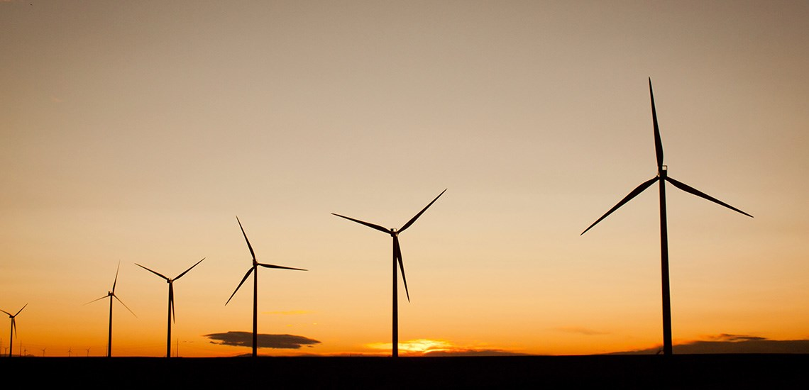 wind turbines against an evening sky